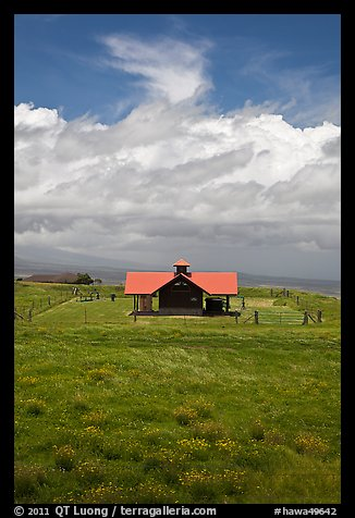 Rural building with bright red roof in ranchland. Big Island, Hawaii, USA