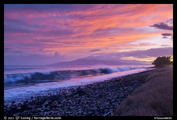 Crashing wave, Lanai Island, and colorful sunset clouds. Lahaina, Maui, Hawaii, USA (color)