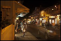 Tourists strolling store-lined street at night. Lahaina, Maui, Hawaii, USA ( color)