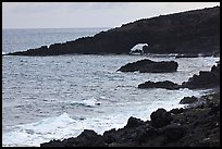 Dark coastline with sea tunnel. Maui, Hawaii, USA (color)