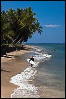 Surfer walking on beach. Lahaina, Maui, Hawaii, USA