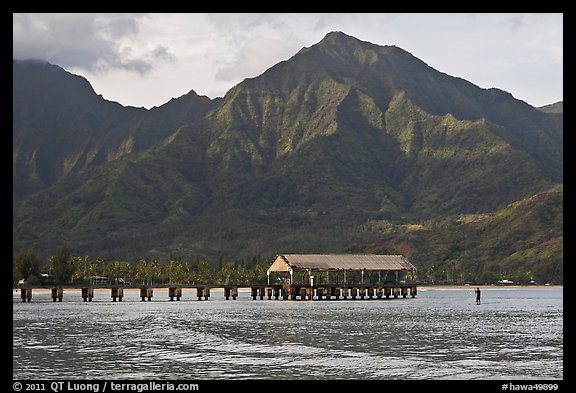 Hanalei Pier, mountains, and surfer. Kauai island, Hawaii, USA (color)