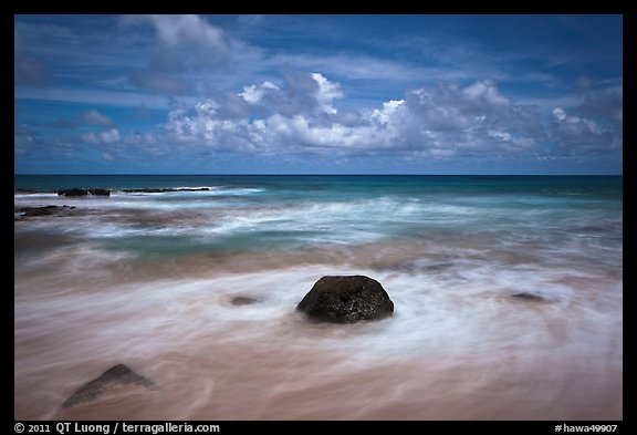 Volcanic rock and wave motion. Kauai island, Hawaii, USA (color)