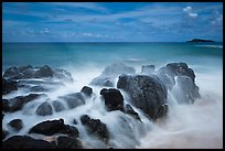 Rock with water motion and Mokuaeae island. Kauai island, Hawaii, USA (color)