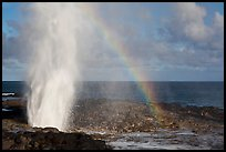 Spouting Horn with rainbow, late afternoon. Kauai island, Hawaii, USA