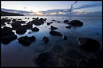 Boulders in water near Kalihika Park, sunset. Kauai island, Hawaii, USA (color)