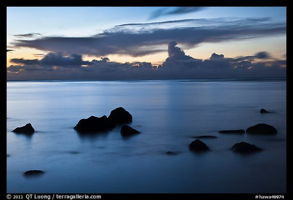 Rocks and cloud band, sunset. Kauai island, Hawaii, USA