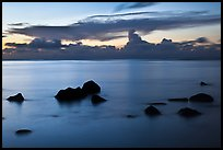 Rocks and cloud band, sunset. Kauai island, Hawaii, USA (color)