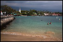 Beach, seawall and town, Kailua-Kona. Hawaii, USA (color)