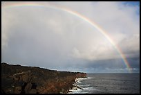 Rainbow over volcanic costline. Big Island, Hawaii, USA (color)