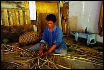 Woman weaving a toga (mat) out of pandamus leaves. American Samoa ( color)