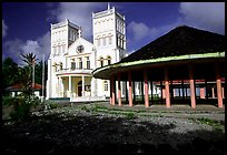 Church and fale in Leone. Tutuila, American Samoa