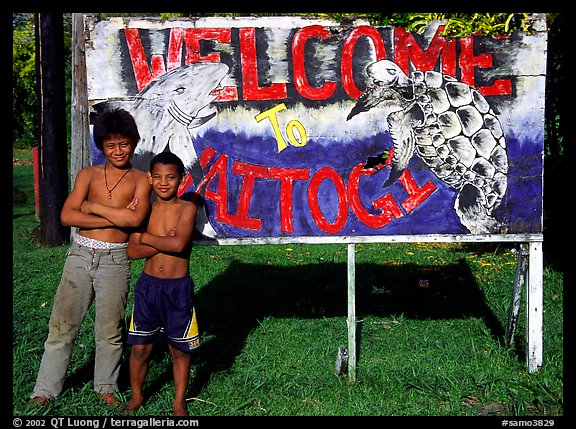 Children in front of a turtle a shark sign in Vaitogi. Tutuila, American Samoa (color)