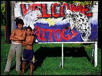 Children in front of a turtle a shark sign in Vaitogi. Tutuila, American Samoa ( color)