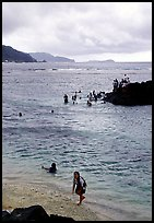 Children playing in water near Fugaalu. Pago Pago, Tutuila, American Samoa