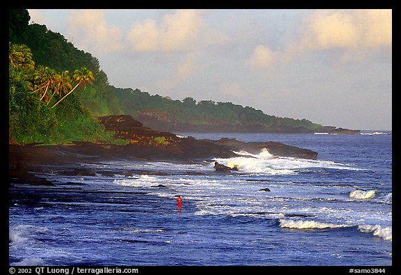 Fisherman on rocky coast near Vailoa. Tutuila, American Samoa (color)