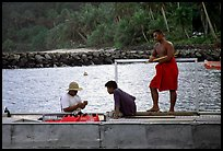 Men on a ferry to Aunuu. Aunuu Island, American Samoa (color)