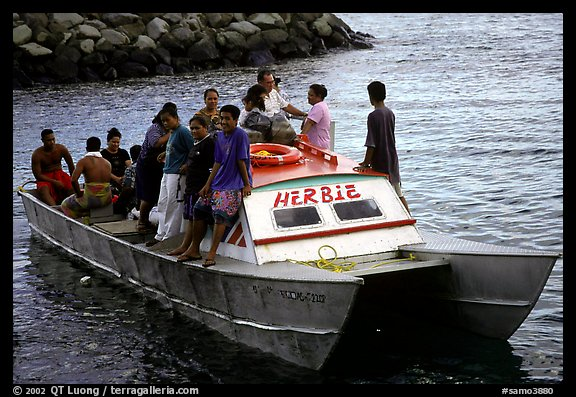 Villagers crowd a ferry to Aunuu. Aunuu Island, American Samoa (color)