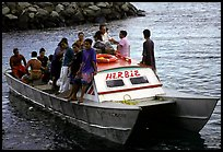 Villagers crowd a ferry to Aunuu. Aunuu Island, American Samoa ( color)
