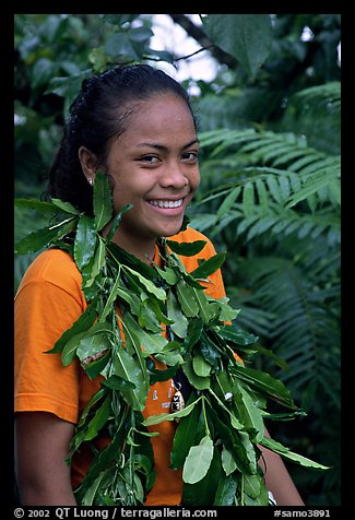 Girl with ornemental leaves in traditional fashion. Pago Pago, Tutuila, American Samoa