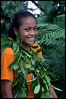 Girl with ornemental leaves in traditional fashion. Pago Pago, Tutuila, American Samoa (color)