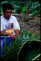 Villager weaving a basket out of a single palm leaf. Tutuila, American Samoa ( color)
