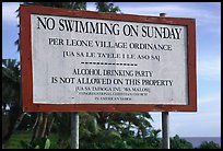 Sign prohibiting activities on Sunday. Tutuila, American Samoa (color)