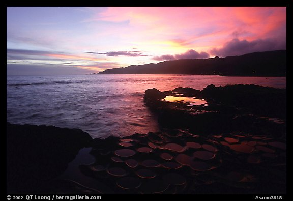 Ancient grinding stones (foaga) and Leone Bay at sunset. Tutuila, American Samoa