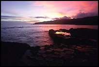 Ancient grinding stones (foaga) and Leone Bay at sunset. Tutuila, American Samoa (color)