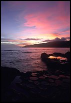 Water-filled  grinding stones holes (foaga) and Leone Bay at sunset. Tutuila, American Samoa (color)