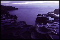 Ancient grinding stones (foaga) and Leone Bay at dusk. Tutuila, American Samoa (color)