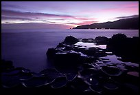 Grinding stones holes (foaga) filled with water at dusk, Leone Bay. Tutuila, American Samoa ( color)