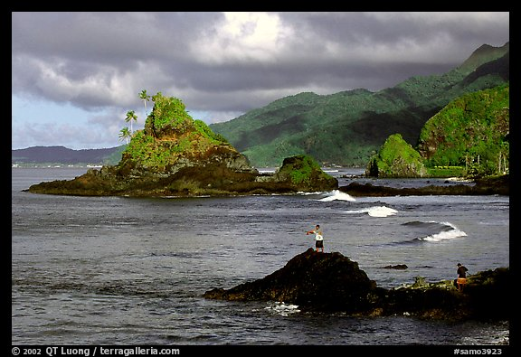 Fishermen on the rocky shore near Maa Kamela. Tutuila, American Samoa (color)