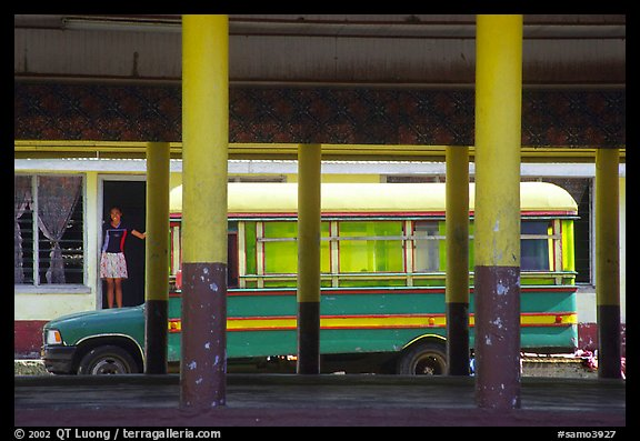 Bus and fale in Masefau village. Tutuila, American Samoa (color)