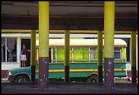Bus and fale in Masefau village. Tutuila, American Samoa ( color)
