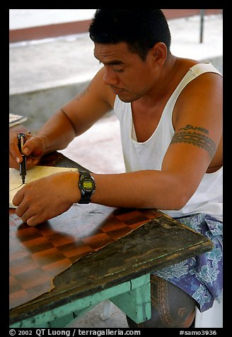 Young man drawing an artwork based on traditional siapo designs. Pago Pago, Tutuila, American Samoa