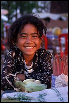 Young incense vendor. Phnom Penh, Cambodia (color)