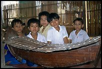 Boys with a traditional musical instrument. Phnom Penh, Cambodia