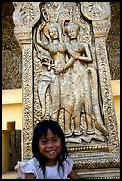 Girl and sculpture at Wat Phnom. Phnom Penh, Cambodia ( color)