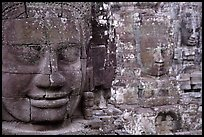 Serene and massive stone faces, the Bayon. Angkor, Cambodia (color)