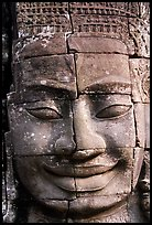 Enigmatic stone smiling face, the Bayon. Angkor, Cambodia (color)
