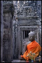 Buddha image, swathed in reverence, with offerings, the Bayon. Angkor, Cambodia (color)