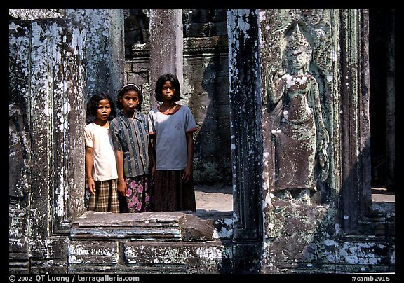 Girls in temple complex, the Bayon. Angkor, Cambodia