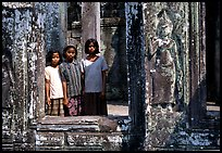 Girls in temple complex, the Bayon. Angkor, Cambodia ( color)