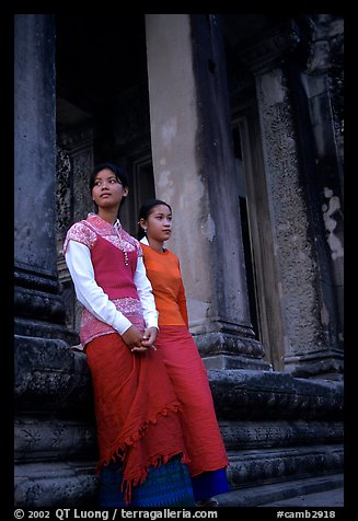 Elegant young women near temple entrance. Angkor, Cambodia