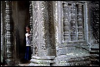 Girl hides in Ta Prom. Angkor, Cambodia ( color)