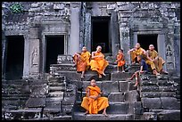 Buddhist monks sitting on steps, Angkor Wat. Angkor, Cambodia (color)
