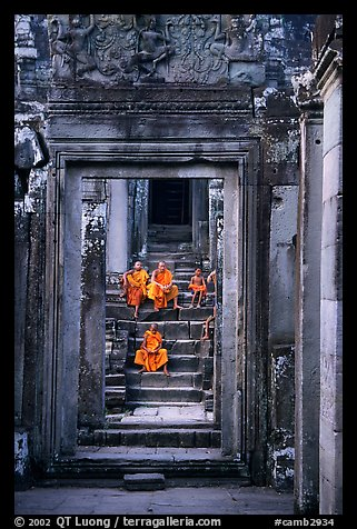 Buddhist monks in the Bayon. Angkor, Cambodia