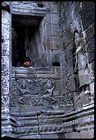 Boy hides in the Bayon. Angkor, Cambodia (color)