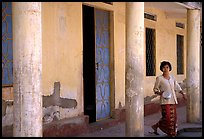 Woman in downtown building. Phnom Penh, Cambodia